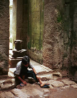 a cambodian young boy waiting for the next traveler to earn some money